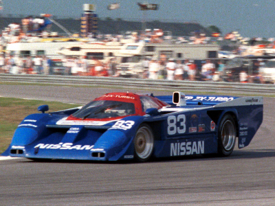 <h4>IMSA Nissan 83 at speed</h4><br /><p>Shows the IMSA Nissan rounding the corner on the Daytona Track in the early 90's<br /></p><p>Beautiful</p>
