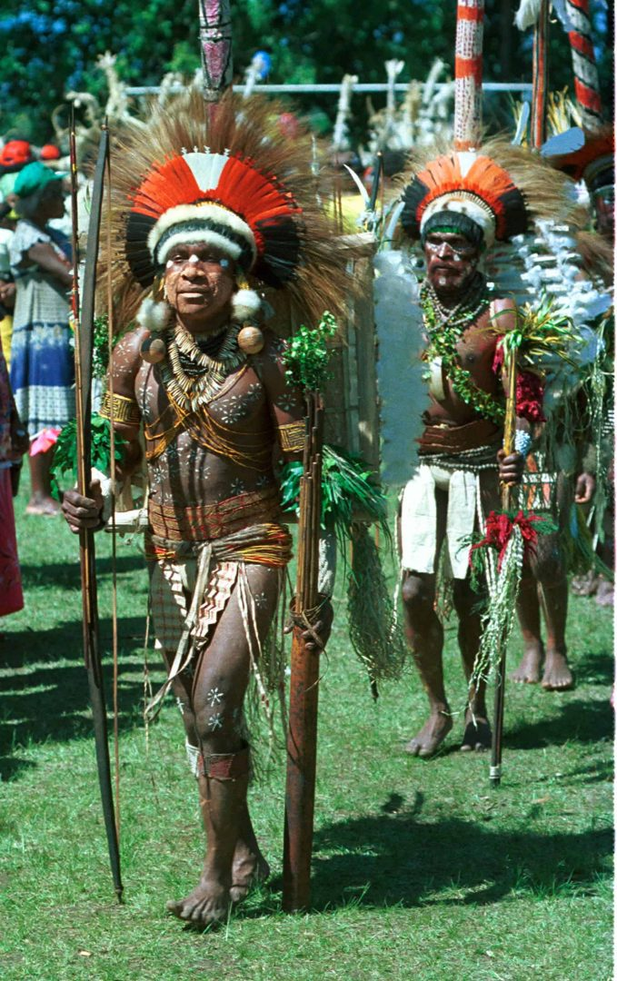 His bow is taller than he is. His body painting art and decorations set him apart from a large portion of the competitors. Taken in Goroka mid 80's.