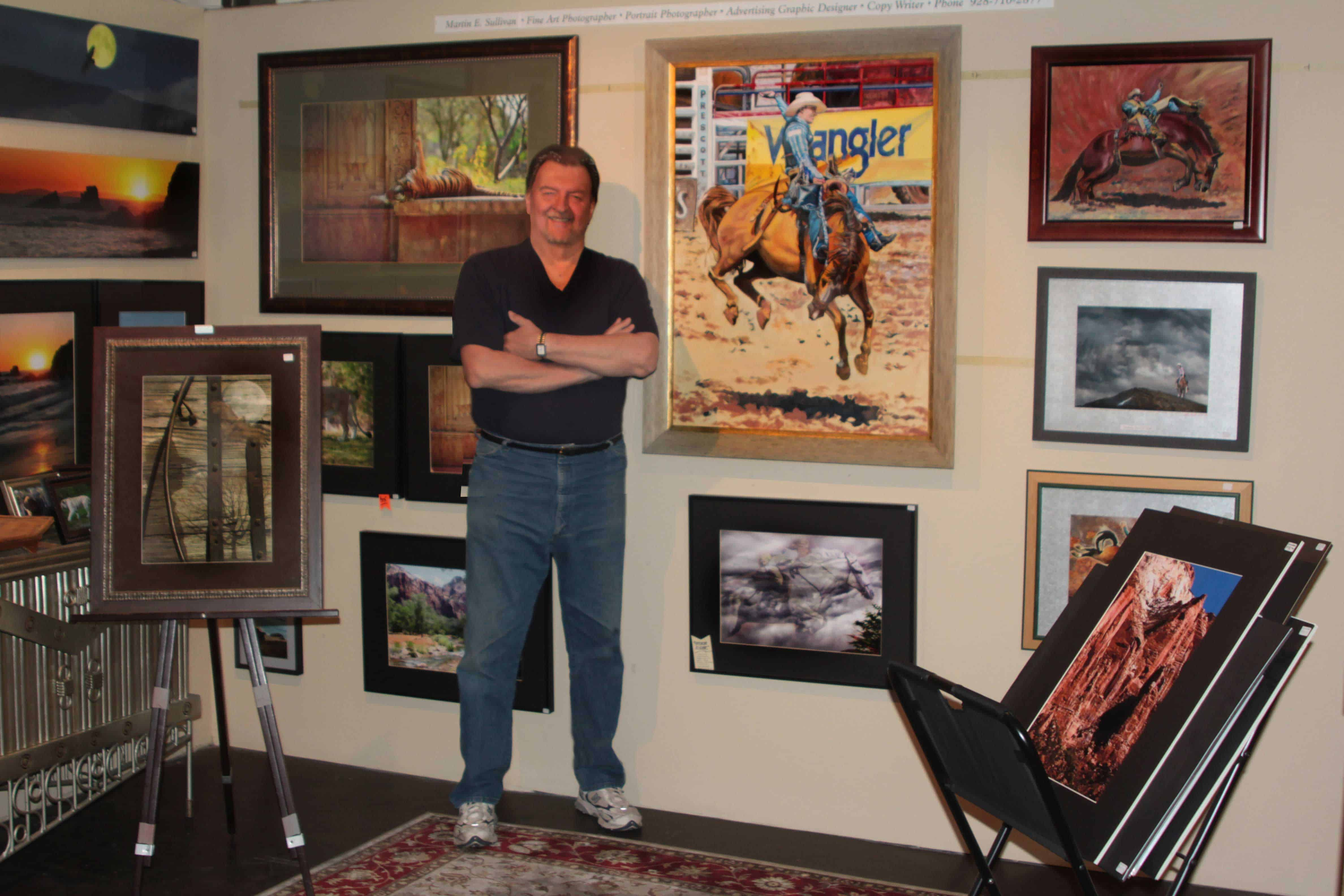 <h4>Yes, its me posing for you</h4><br> <p>Taken when I had gallery space in Prescott Arizona. The rodeo rider is an oil painting I'm still working on. It seems I'm always adding or changing something on it. One day I'll call it done... just not yet.</p>